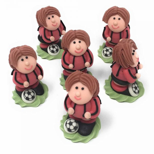 red footballer cake decorations